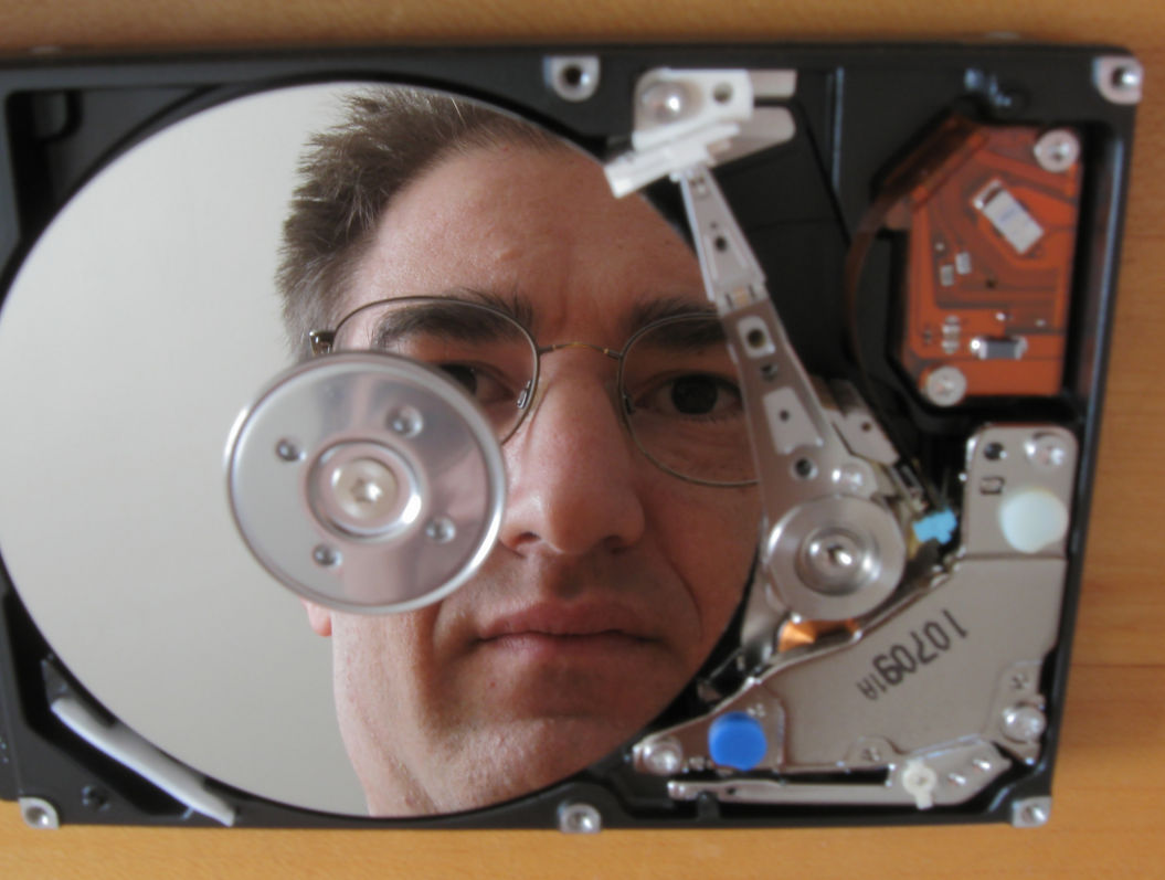 Norman, reflected in a hard disk